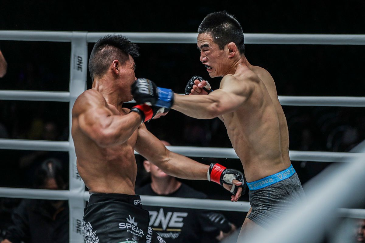 Chinese mixed martial arts Liu Peng Shuai throws a left hook