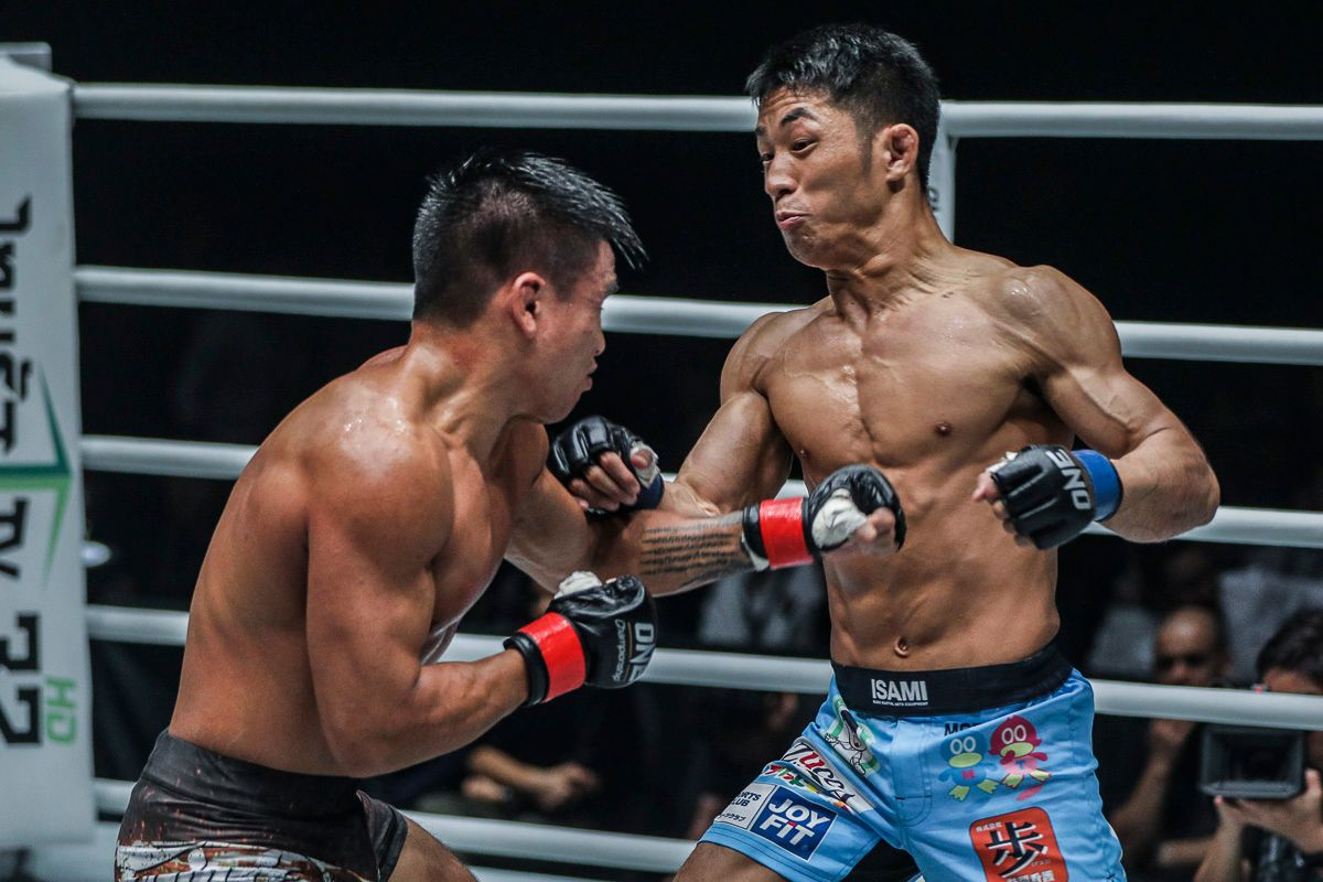 Daichi Takenaka attacks Mark Fairtex Abelardo