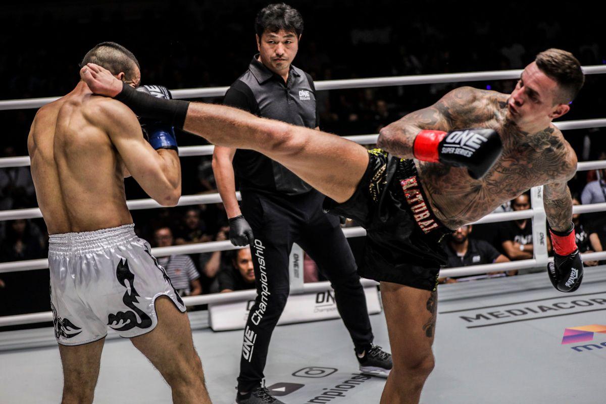 Dutch kickboxer Nieky Holzken throws a head kick