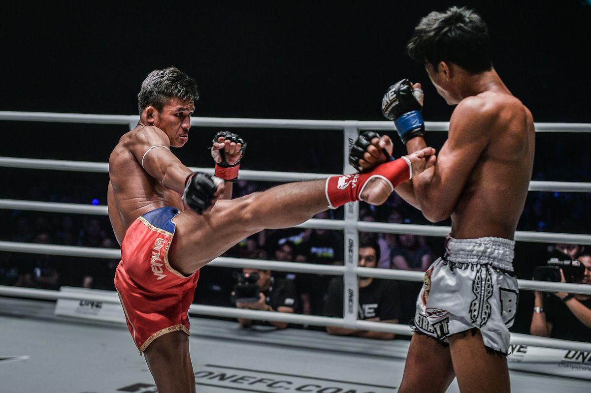 Muay Thai World Champion Superlek Kitmoo9 throws a roundhouse kick