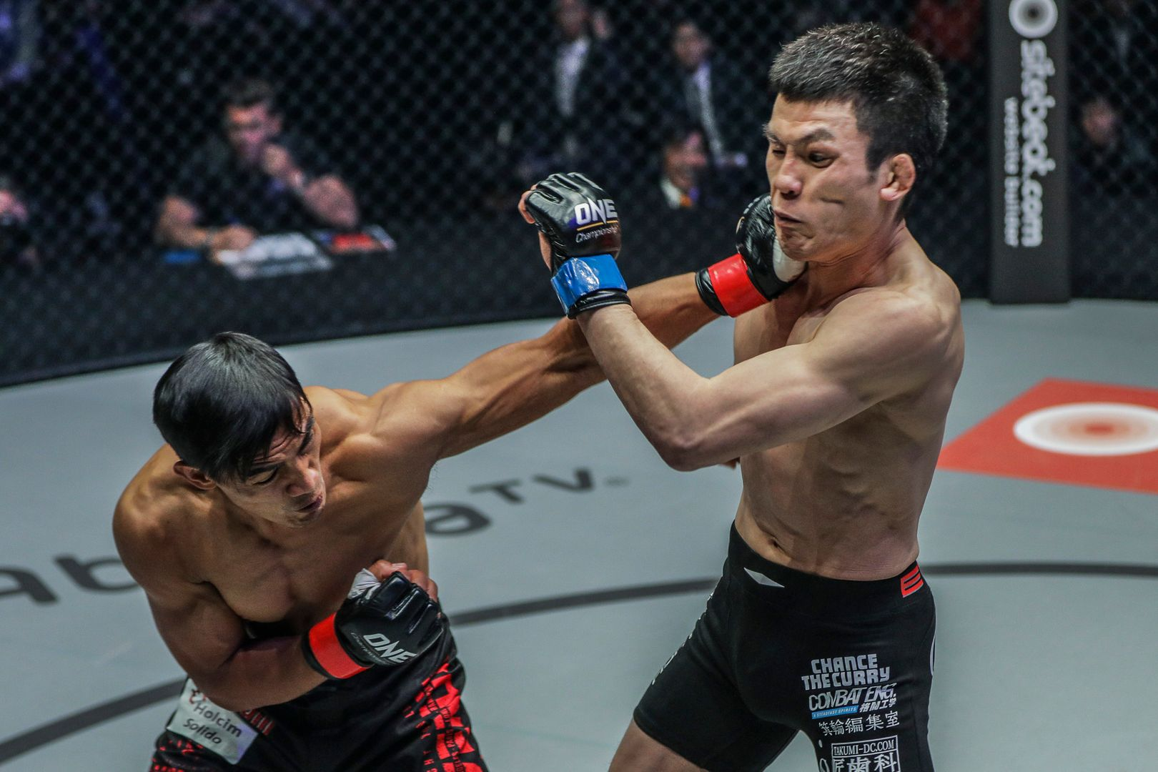 Filipino MMA fighter Eduard Folayang punches Shinya Aoki in their rematch