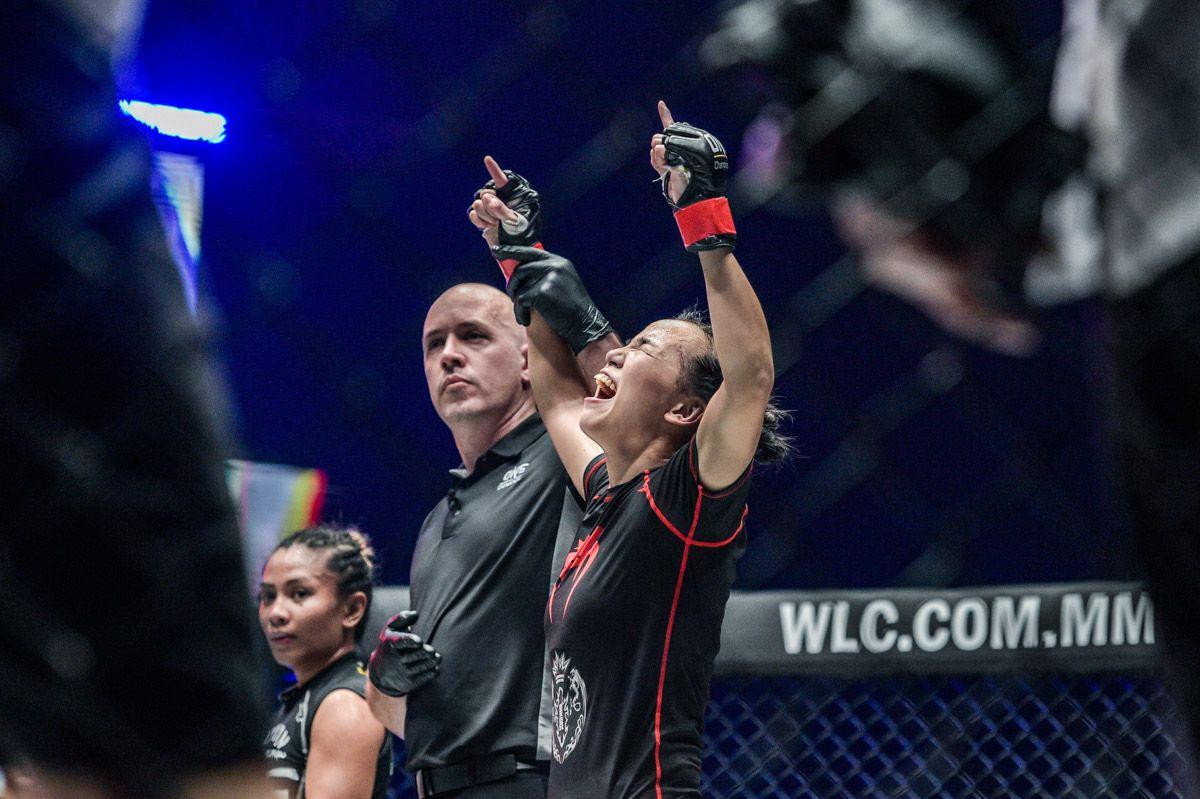 """MMA Sister"" Lin Heqin celebrates her win"