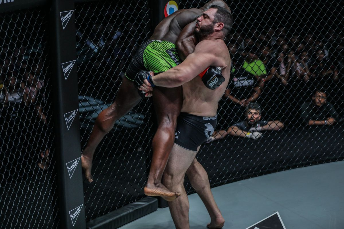 "Mauro ""the Hammer"" cerilli grapples with Alain ""The Panther"" Ngalani at ONE: REIGN OF VALOR"