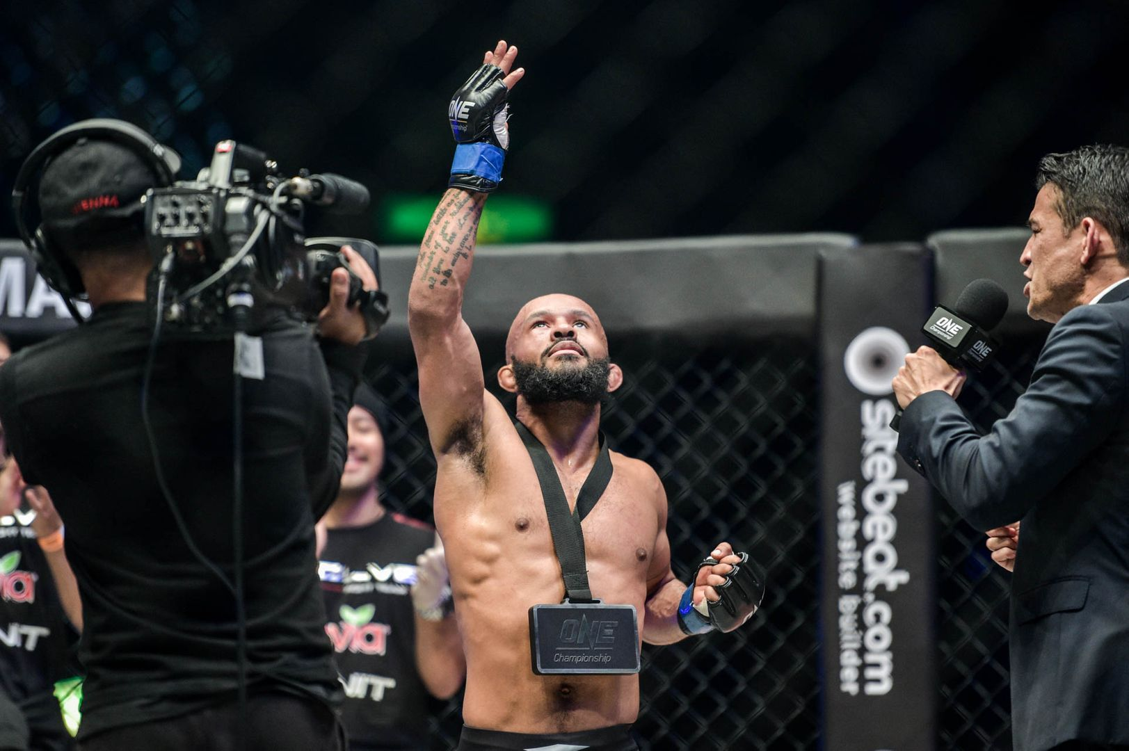 Demetrious Johnson celebrates his submission of Yuya Wakamatsu at ONE: A NEW ERA