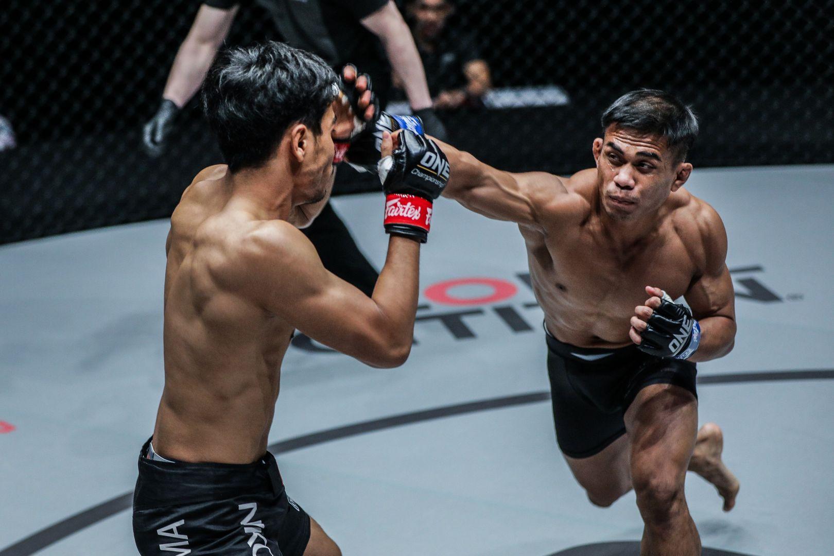 Indonesian MMA fighter Eko Roni Saputra throws a right cross