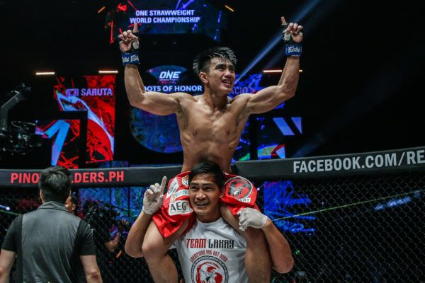 Joshua PAcio celebrates with Eduard Folayang