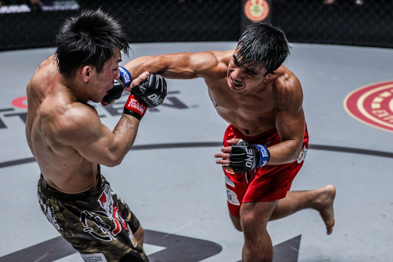 Filipino MMA fighter Joshua Pacio punches Yosuke Saruta