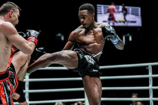 Dutch kickboxer Brown Pinas throws a roundhouse