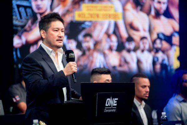 Chatri Sityodtong mans the podium for an announcement.