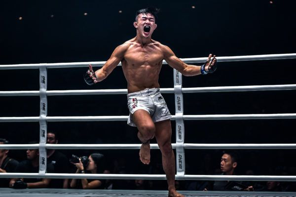 Christian Lee celebrates winning the ONE Lightweight World Title