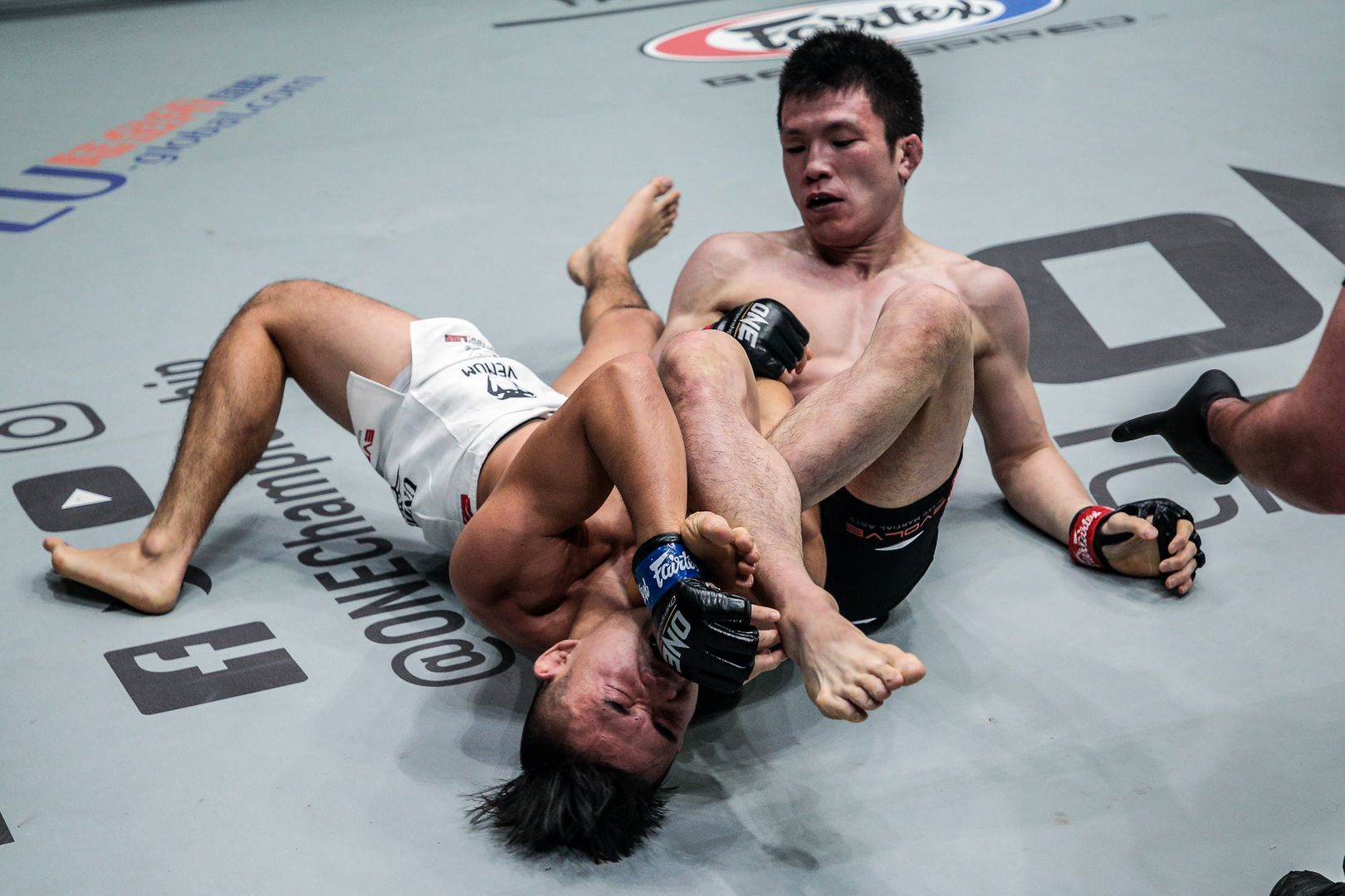 Japanese legend Shinya Aoki puts Christian Lee in an armbar