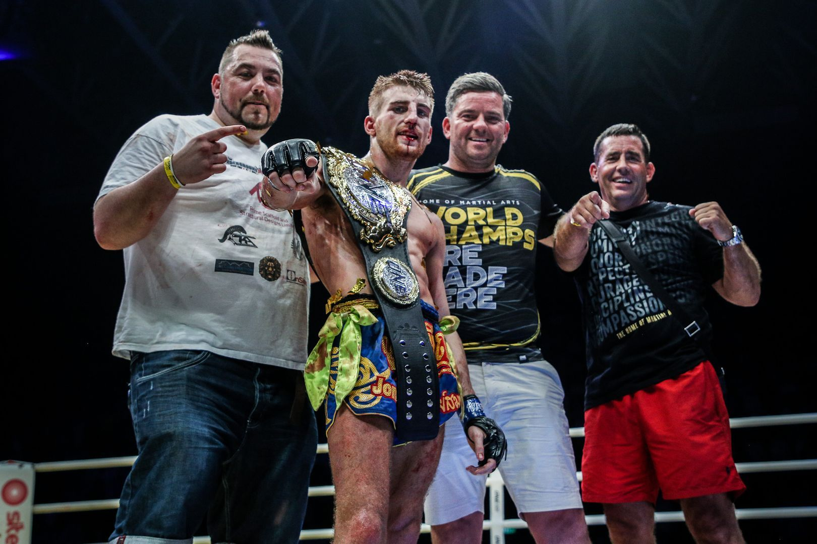 Jonathan Haggerty and his team with the ONE Flyweight Muay Thai World Title belt