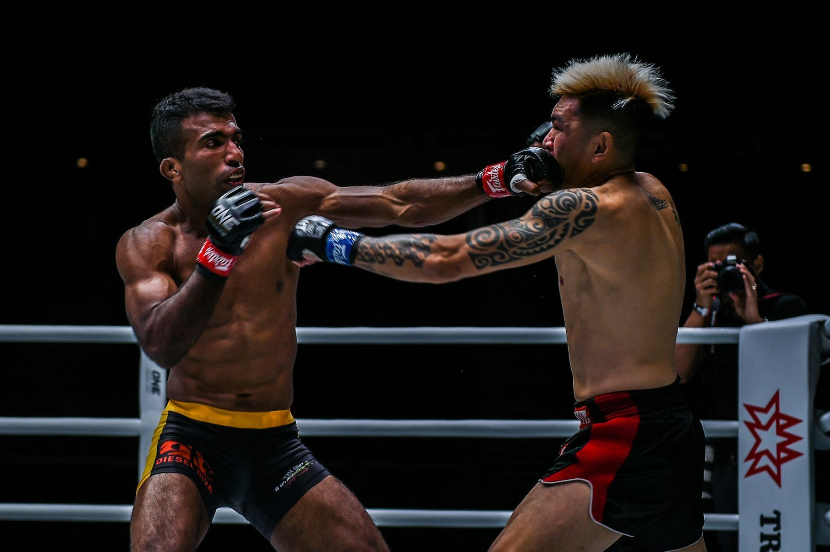 Indian MMA fighter Rahul Raju punches Richard Corminal