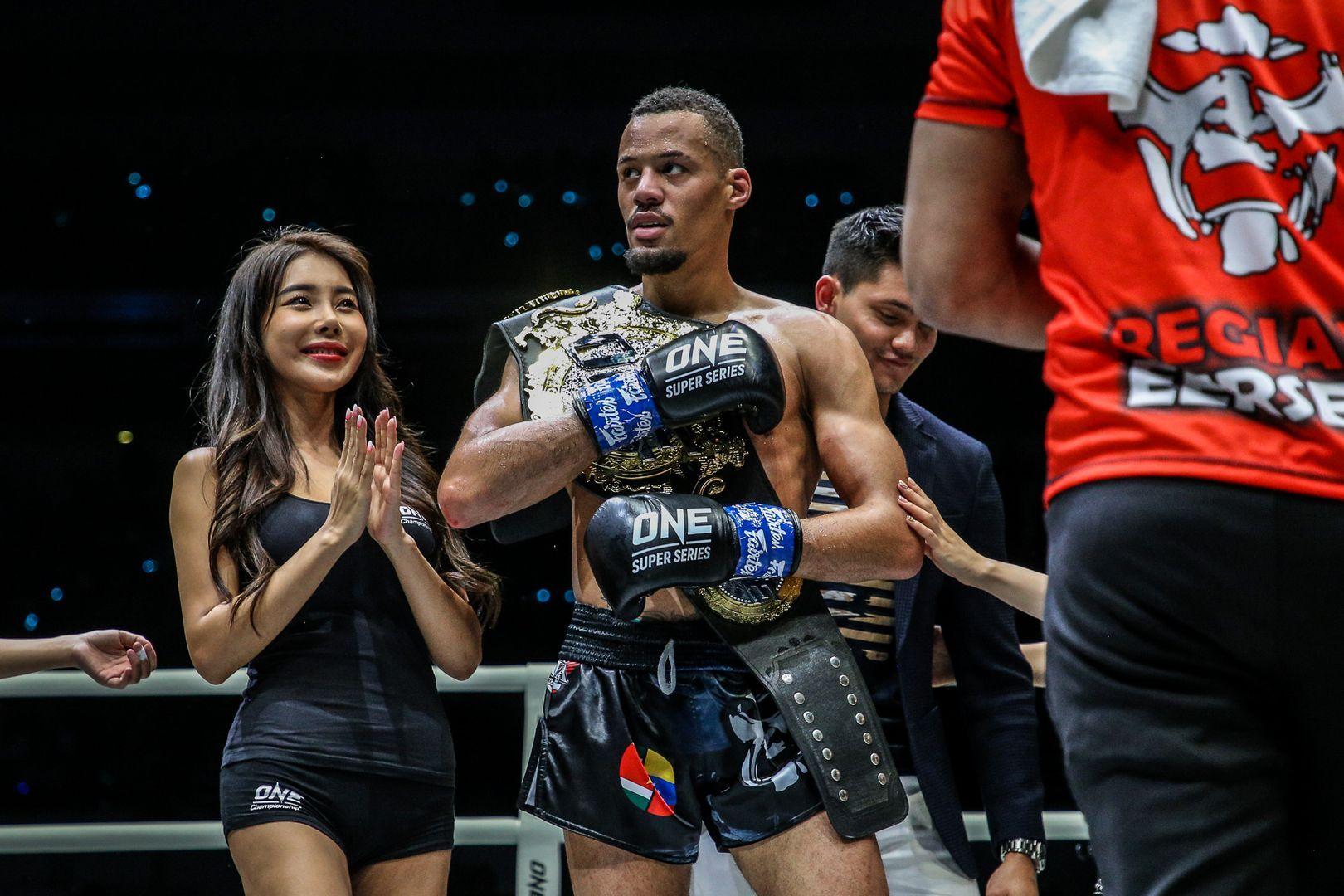 Regian Eersel holds the ONE Lightweight Kickboxing World Title belt