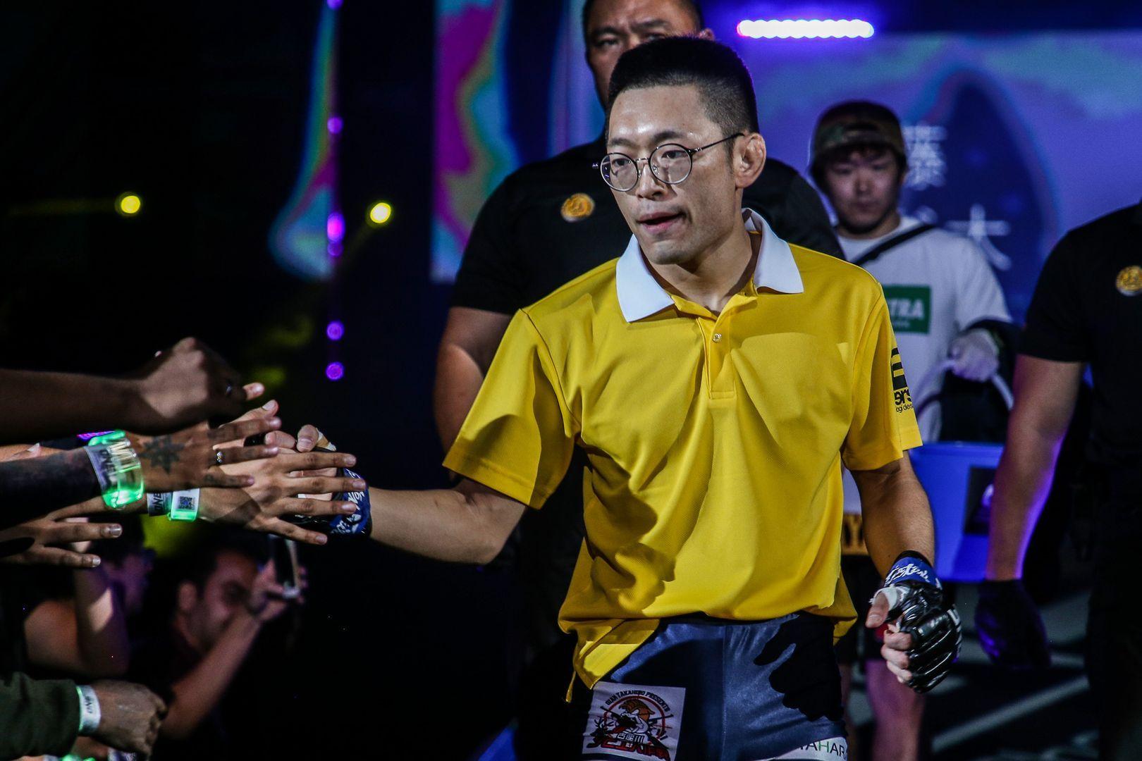 Japanese mixed martial artist Yoshitaka Naito walks to the Circle dressed as Nobita