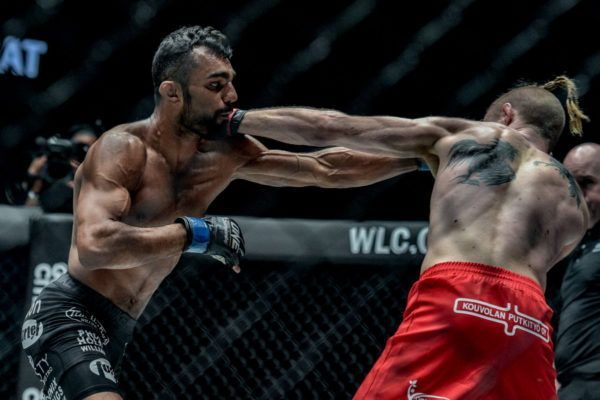 Indian MMA fighter Gurdarshan Mangat punches Toni Tauru