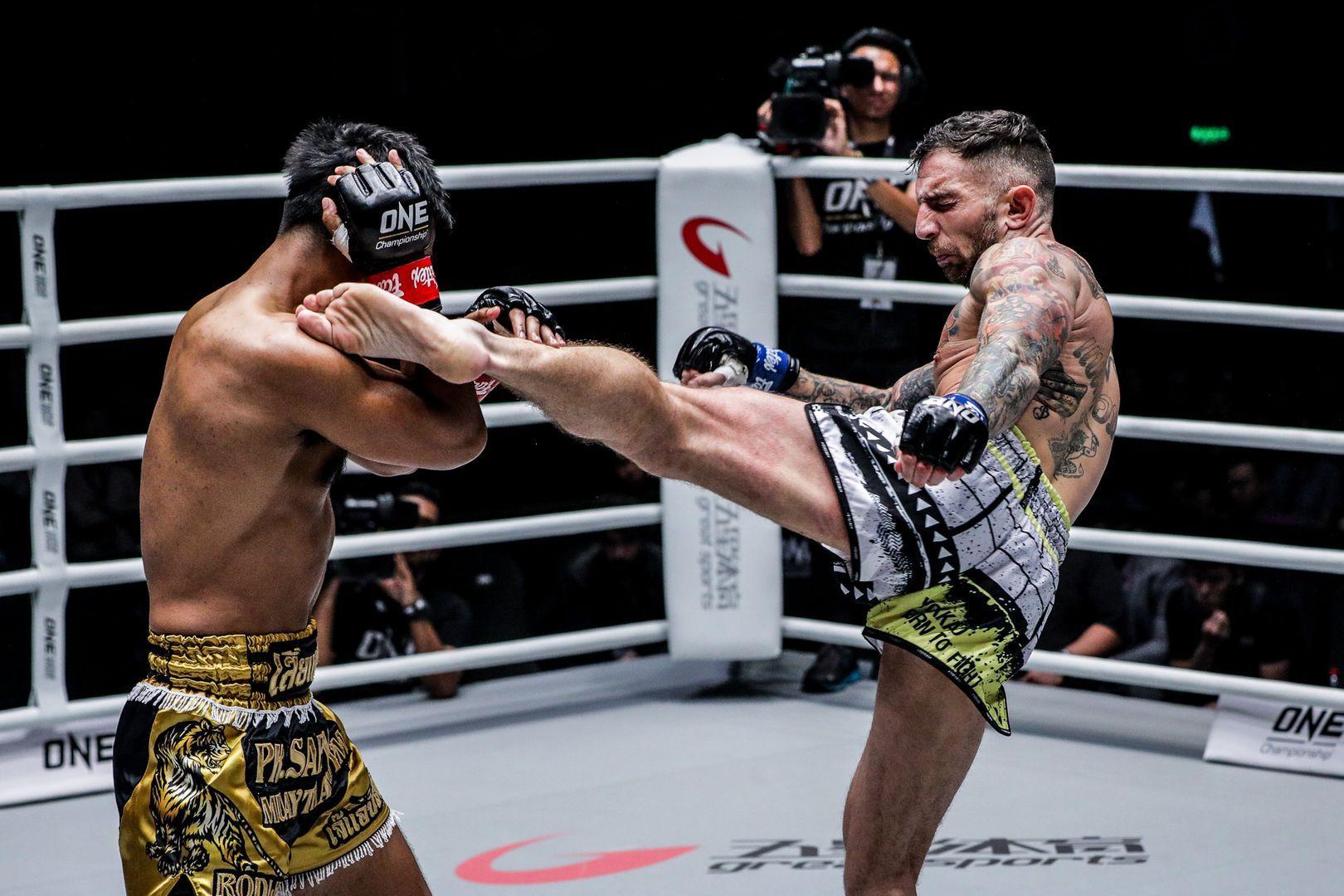 British Muay Thai World Champion Liam Harrison goes for a head kick on Rodlek