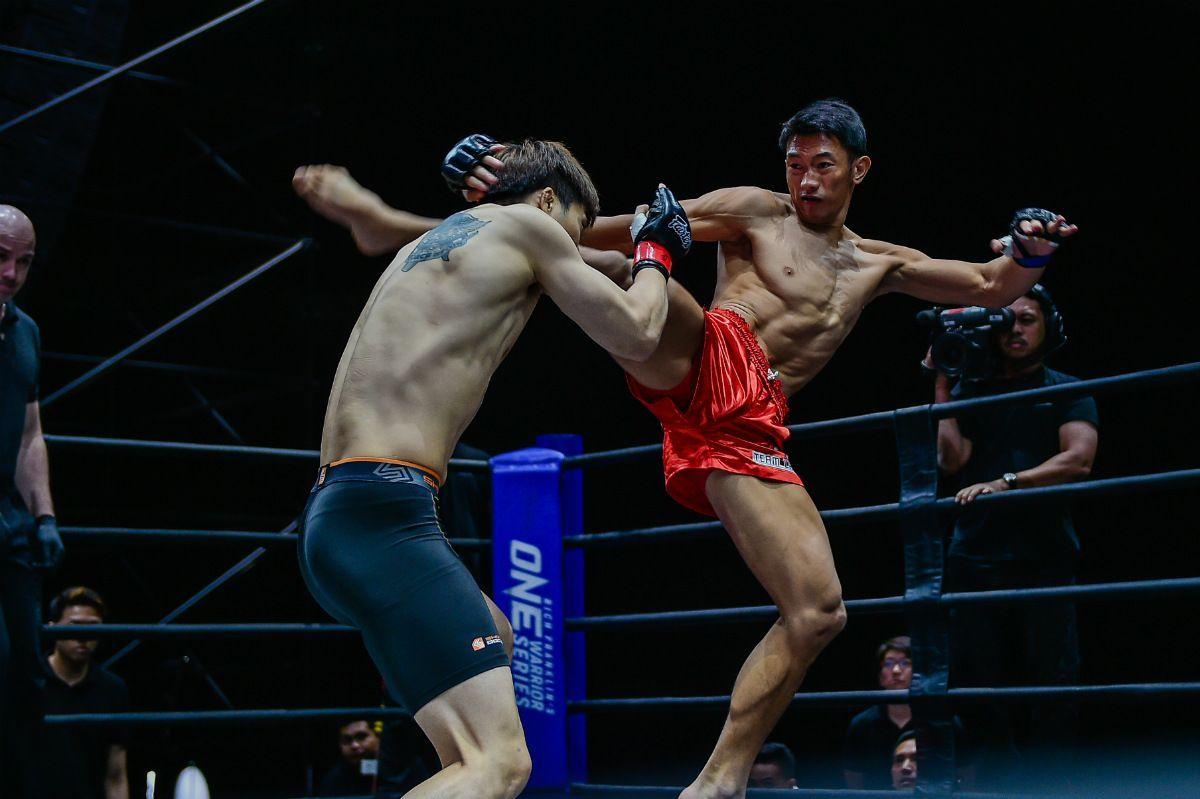 Filipino MMA fighter Jerry Olsim lands a head kick