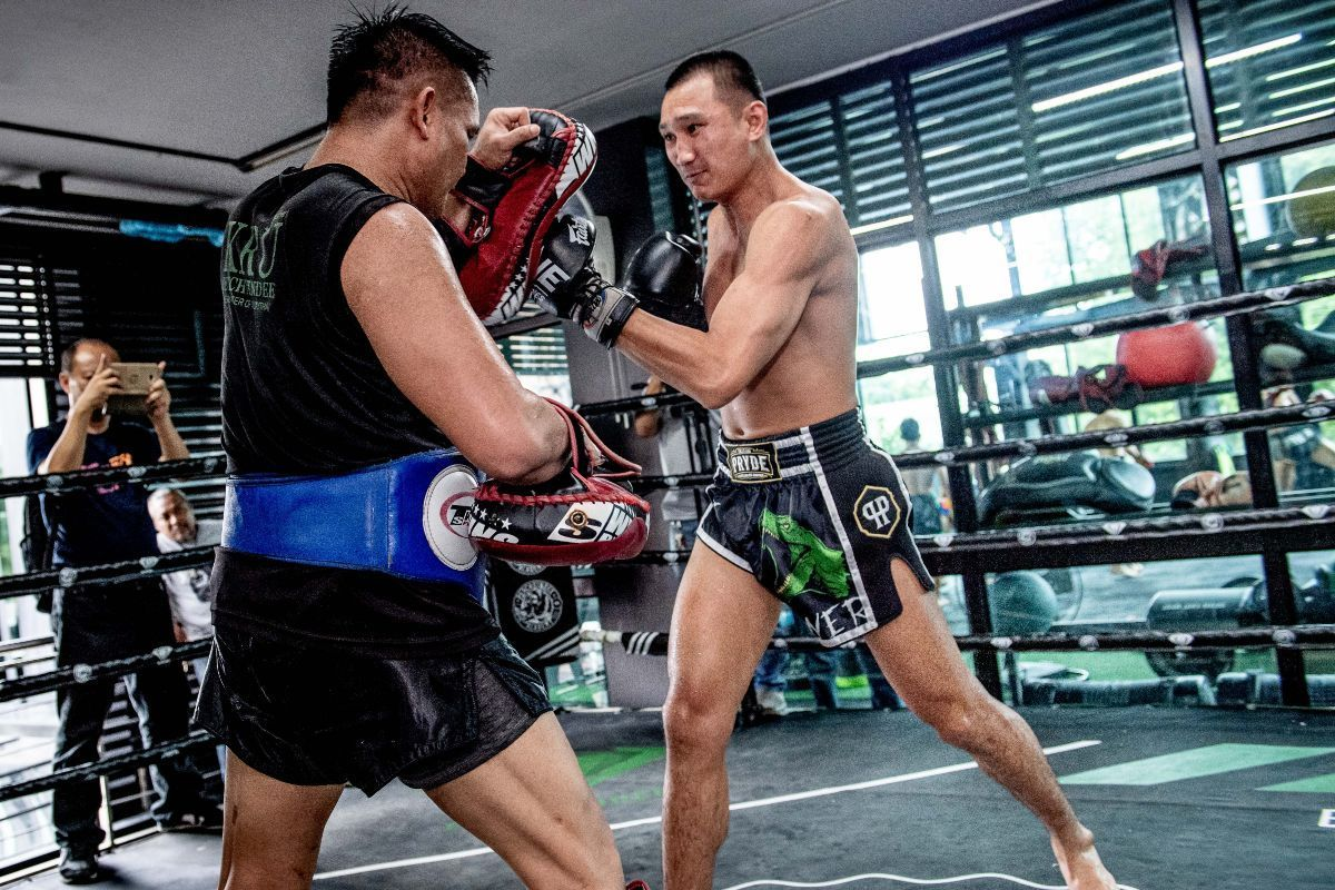 ONE Featherweight Muay Thai World Champion Petchmorakot Petchyindee Academy punches the pad in his Muay Thai shorts
