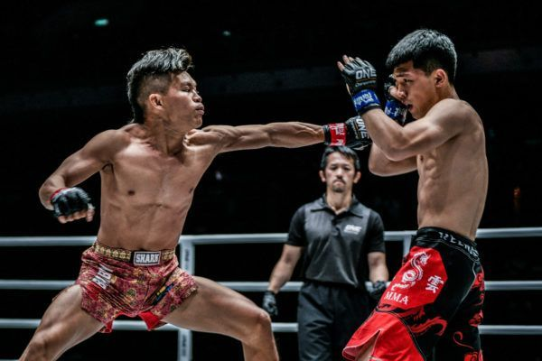 Indonesian mixed martial artist Adrian Mattheis lunges forward with a jab