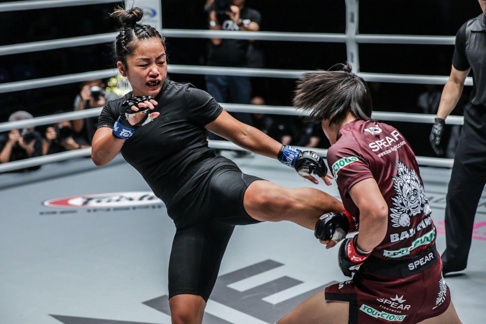 Vietnamese-American Bi Nguyen lands a kick on Myanmar martial arts star Bozhena Antoniyar