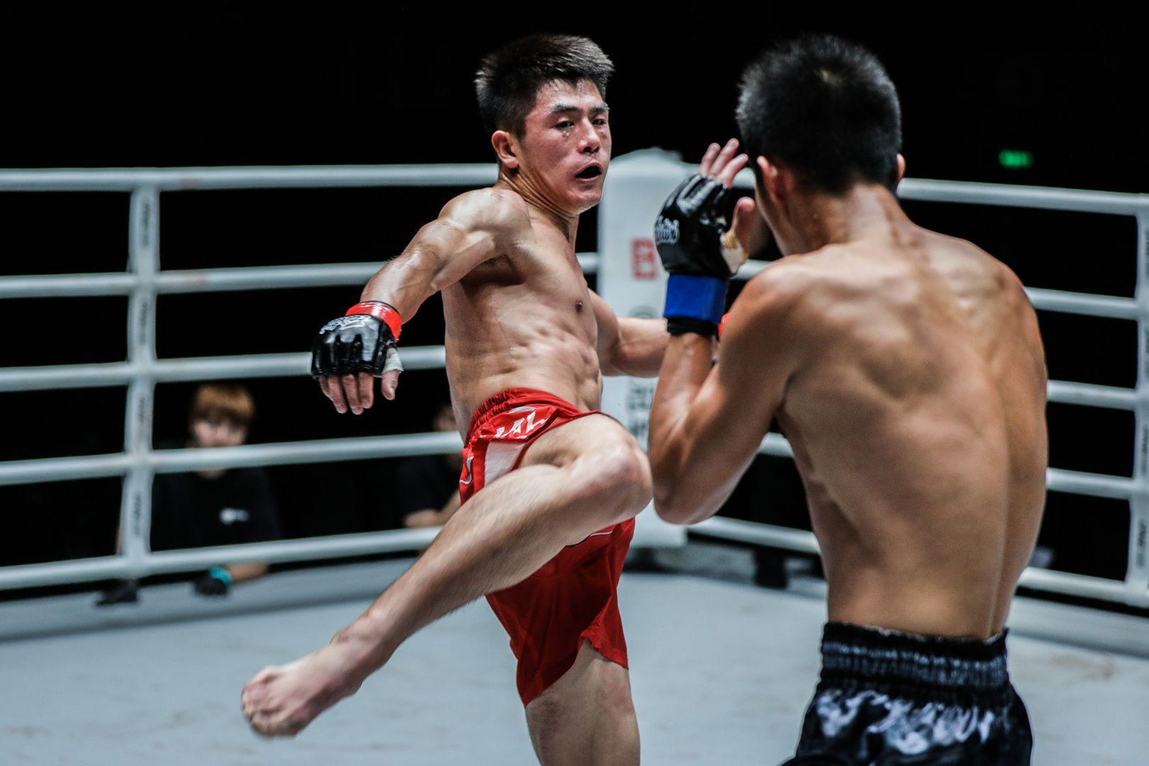 Chinese kickboxer Fu Qing Nan rocks Liu Wei with a body kick