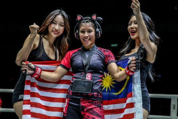 "Malaysian star Jihin ""Shadow Cat"" Radzuan poses with her nation's flag following her victory in July 2019"