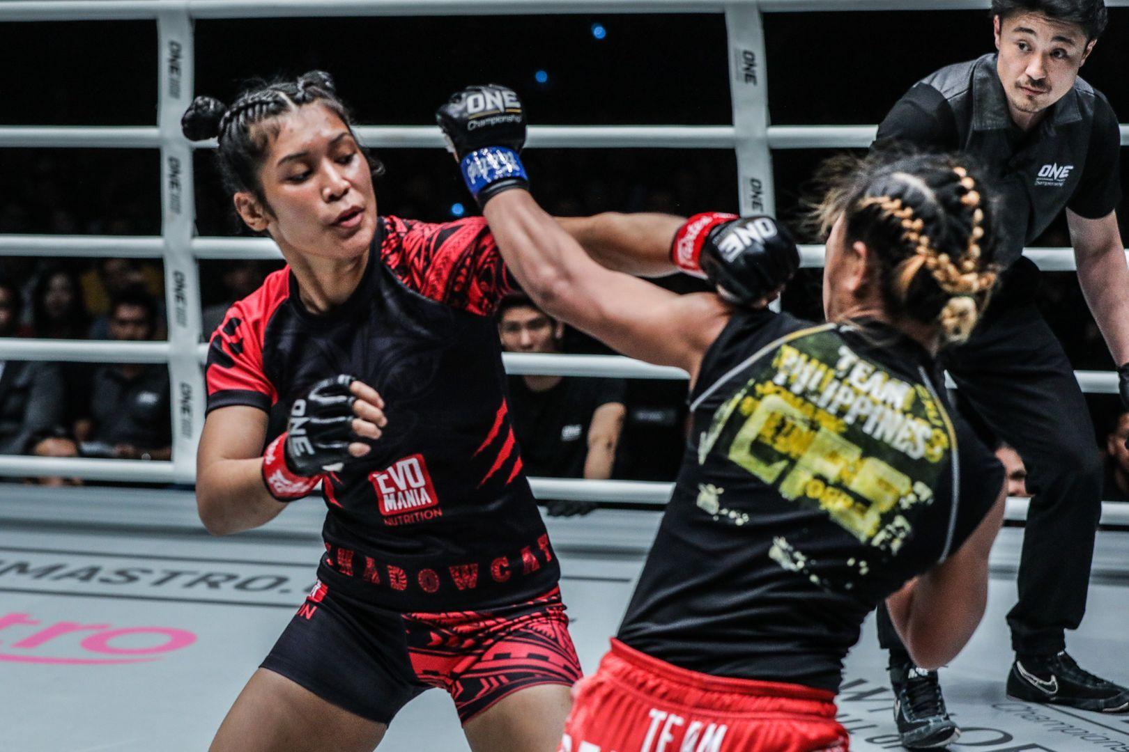 Malaysia's Jihin Radzuan cracks Jomary Torres with a jab