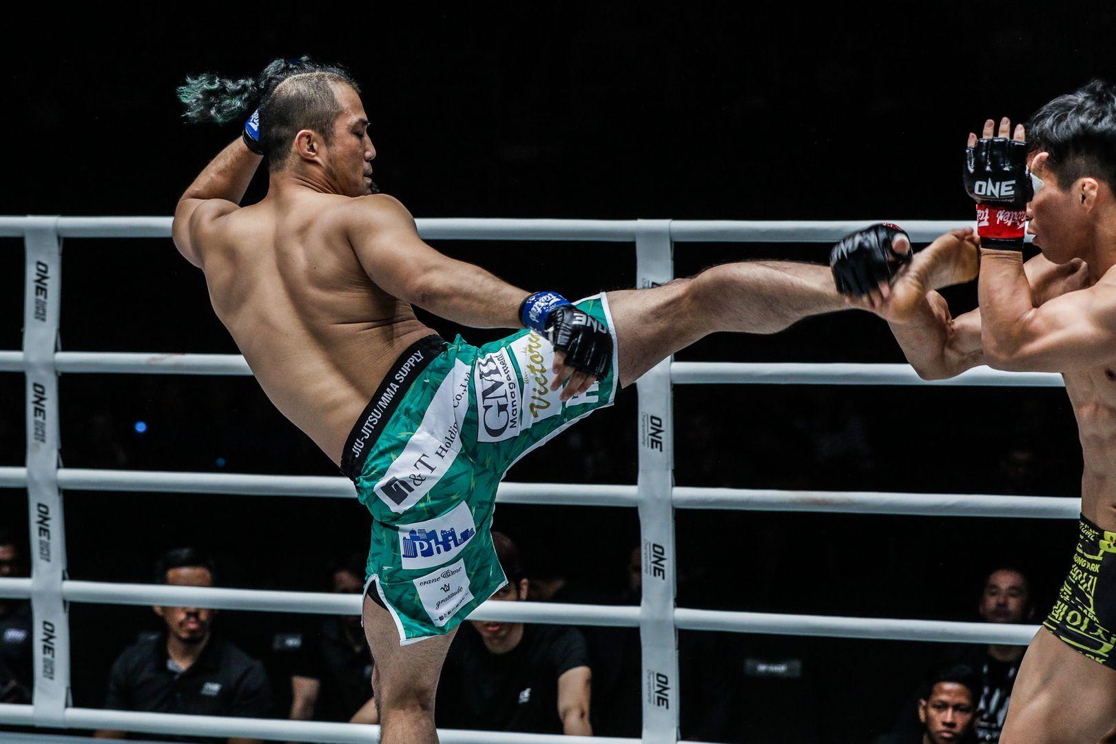 Japanese lightweight Kimihiro Eto throws a roundhouse kick