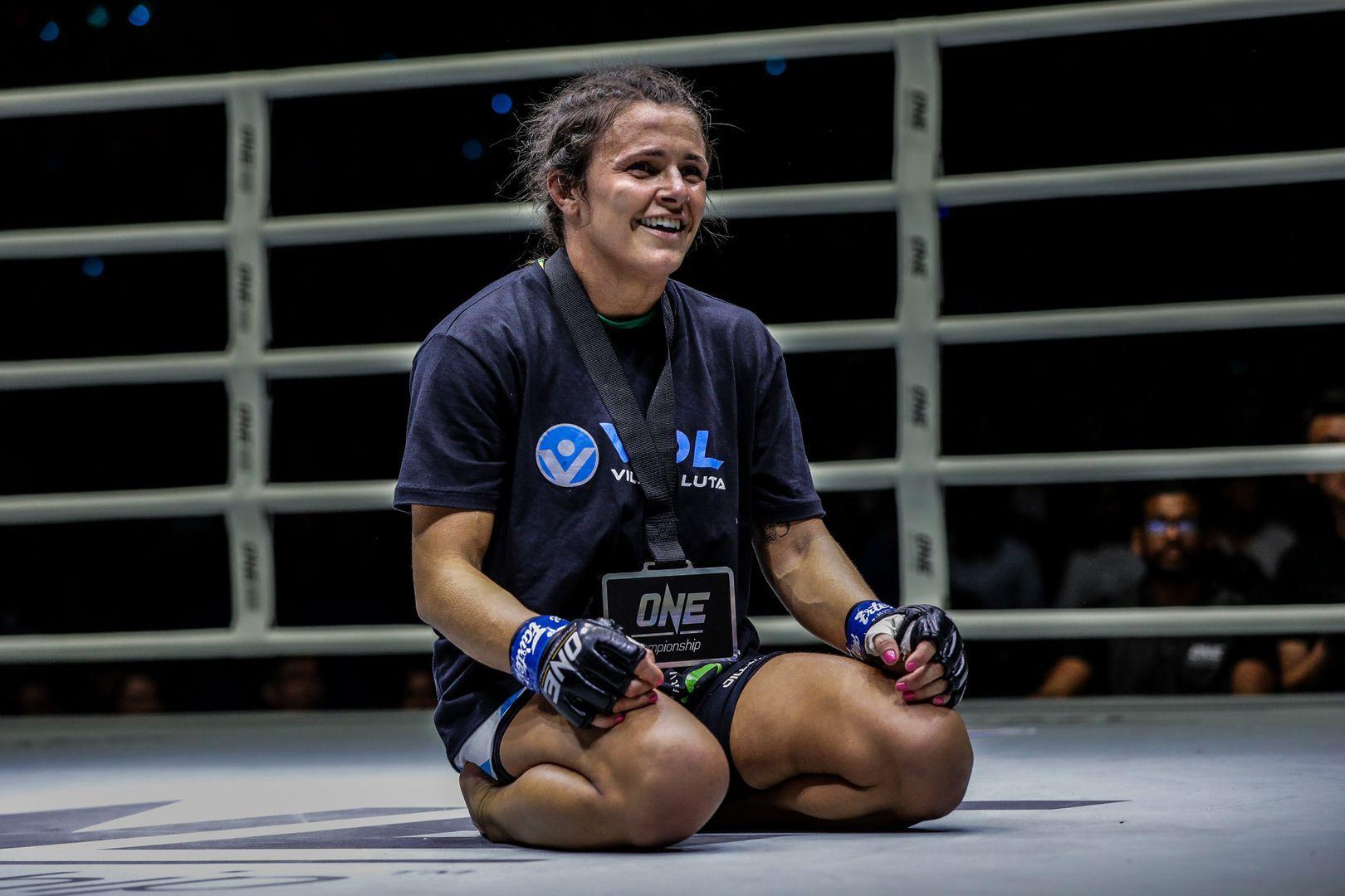 Eight-time Brazilian Jiu-Jitsu World Champion Michelle Nicolini wears the winner's medal following her win