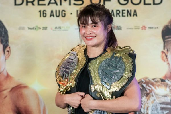 Stamp Fairtex poses with the ONE Atomweight Kickboxing and Muay Thai World Titles