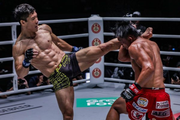 """Crazy Dog"" Dae Sung Park lands a left high kick on Honorio ""The Rock"" Banario at ONE: DAWN OF HEROES"