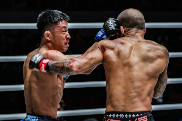 Daichi Takenaka throws a hard right hook to the head at ONE: DAWN OF HEROES.