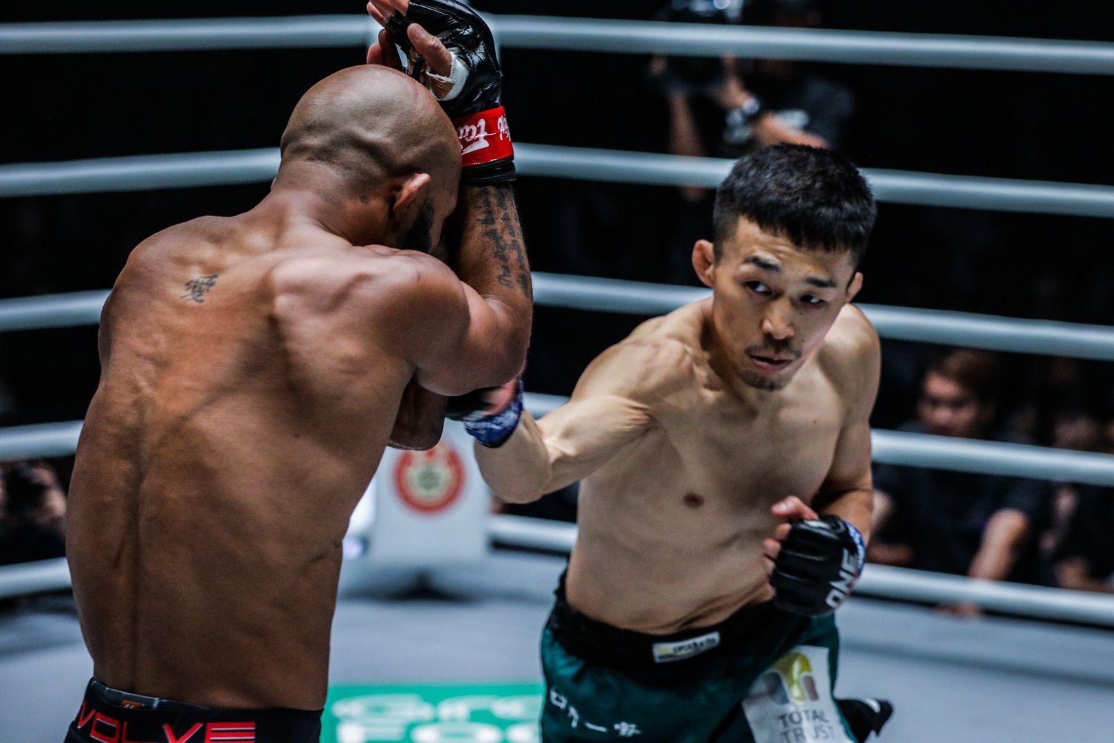 Japanese flyweight Tatsumitsu Wada punches Demetrious Johnson