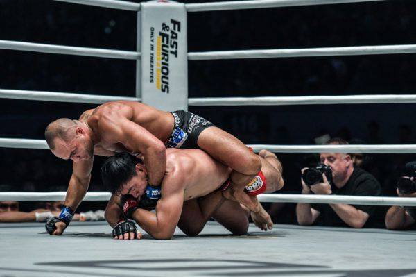 Eddie Alvarez fishes for the rear-naked choke on Eduard Folayang