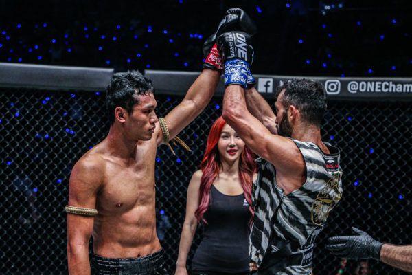 Giorgio Petrosyan and Jo Nattawut show respect in Bangkok, Thailand