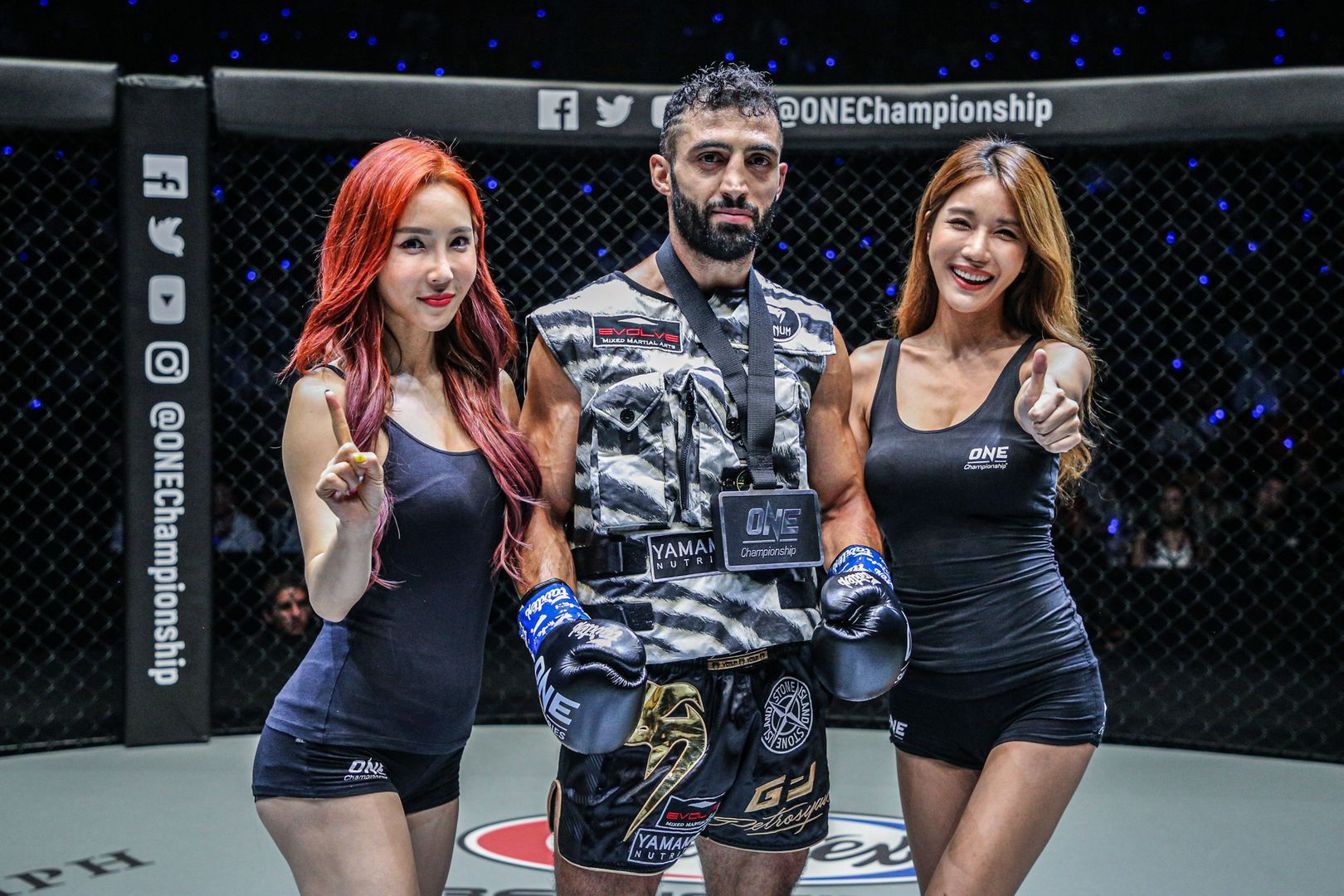 After knocking out Nattawut, Giorgio Petrosyan earns the winner's medal