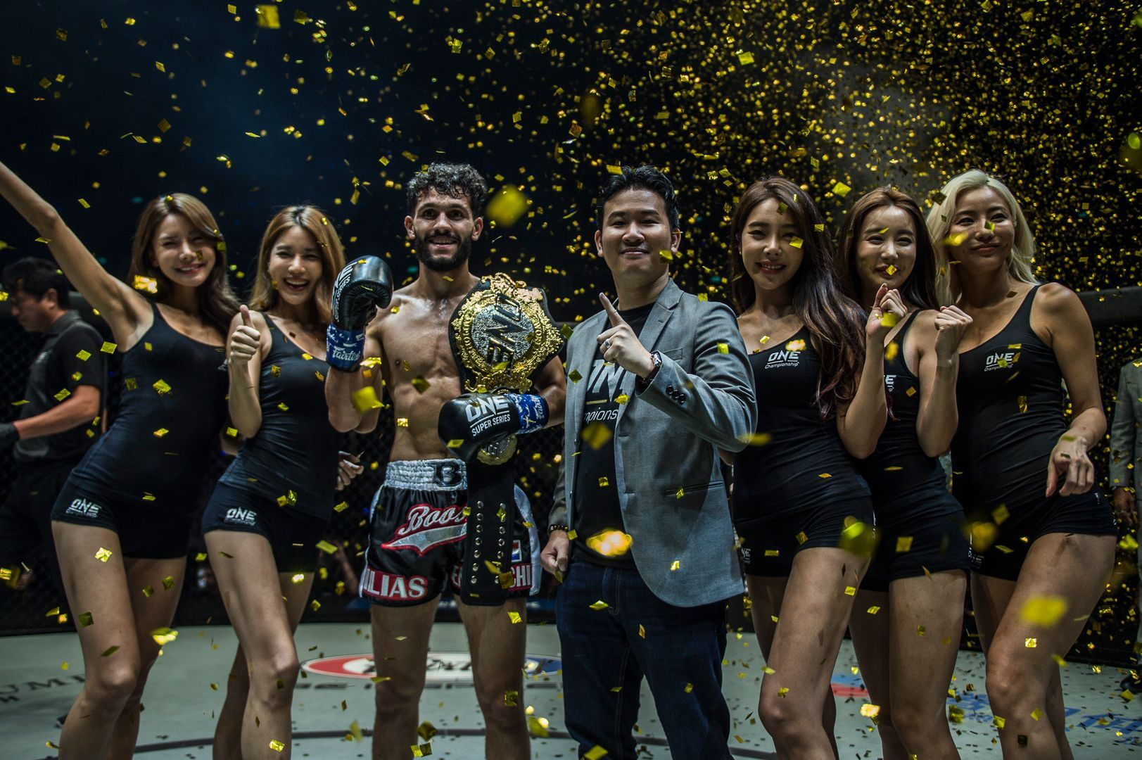 The Netherlands' Ilias Ennahachi celebrates as the new ONE Flyweight Kickboxing World Champion