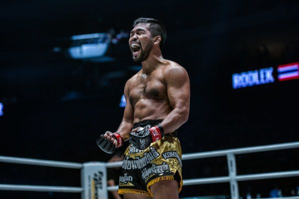 Rodlek PK.Saenchaimuaythaigym celebrates his victory in the ring at ONE: DAWN OF HEROES.