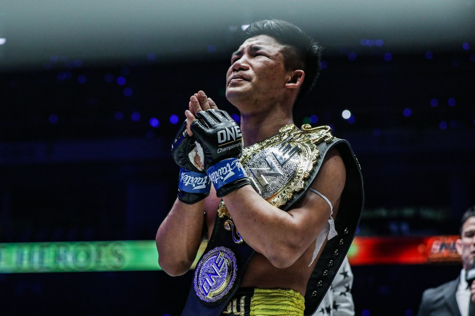 "Rodtang ""The Iron Man"" Jitmuangnon shows his appreciation with the ONE Muay Thai World Title belt over his shoulder."