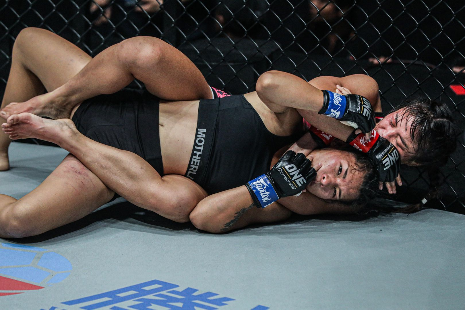 Stamp Fairtex submits Asha Roka via rear-naked choke