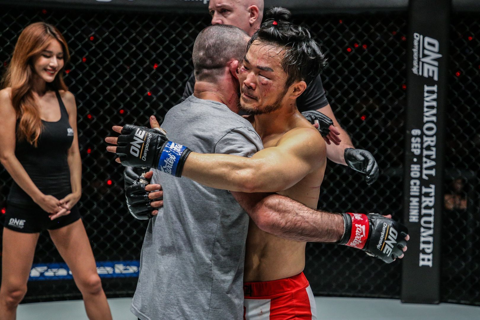 Russian martial artist Yusup Saadulaev hugs South Korean athlete Dae Hwan Kim