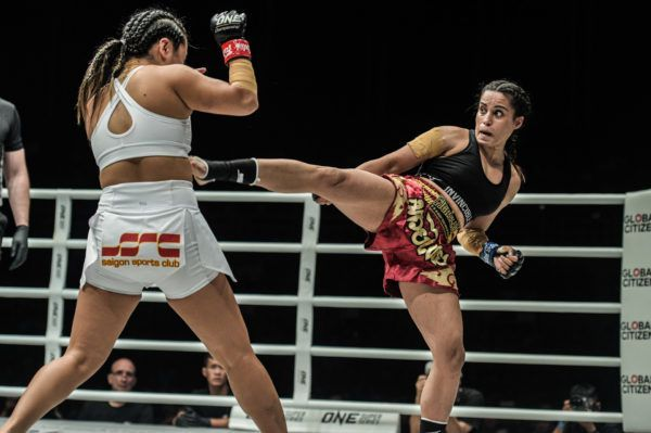 Indian mixed martial artist Puja Tomar throws a kick at Bi Nguyen