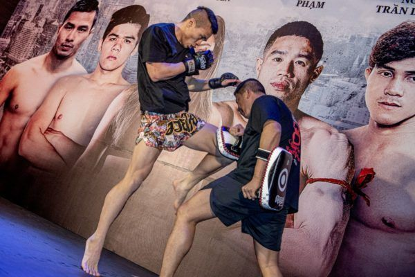 Chris Nguyen hits pads at the ONE: IMMORTAL TRIUMPH open workout in Ho Chi Minh City, Vietnam