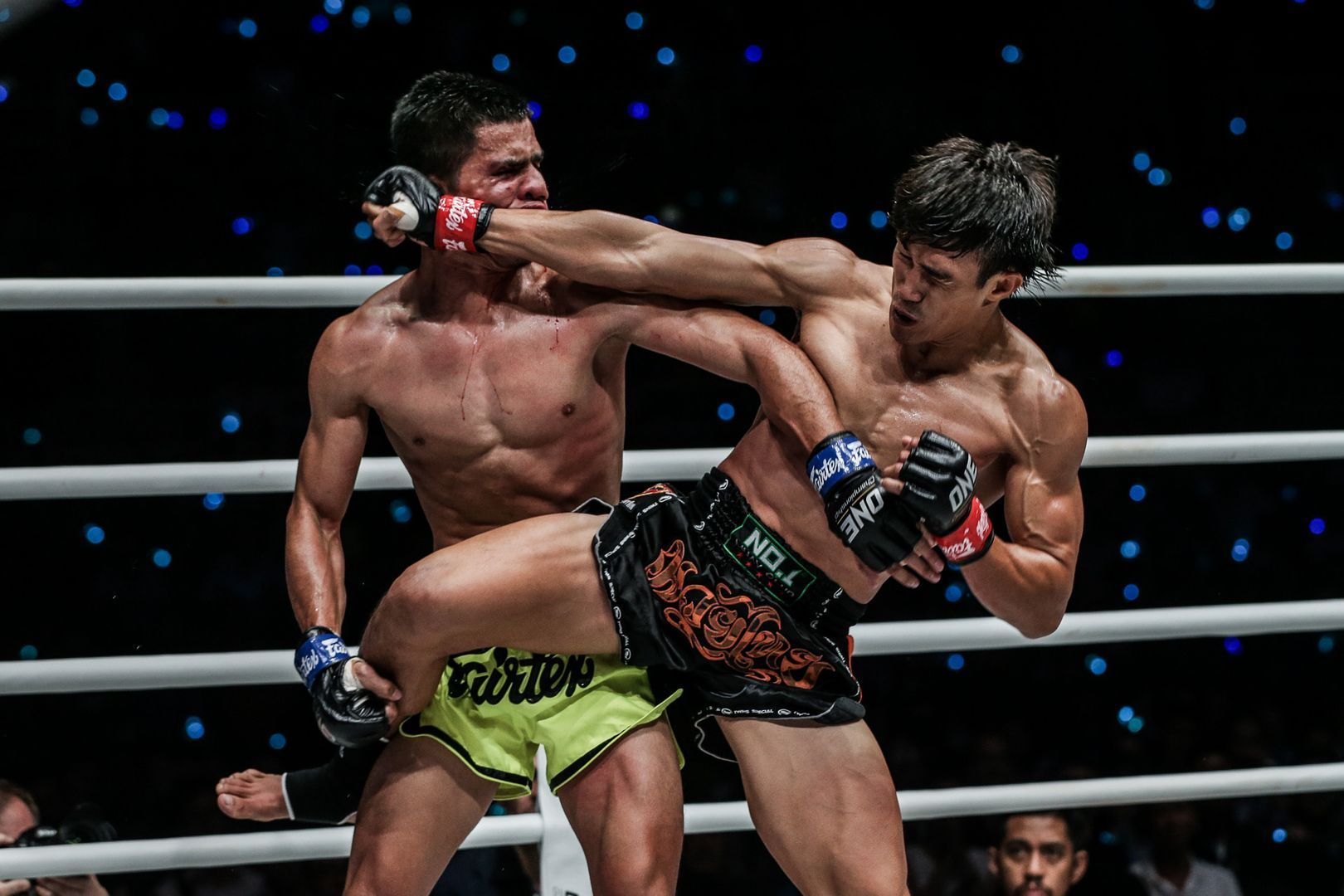 Vietnam's Nguyen Tran Duy Nhat connects with a spinning back fist