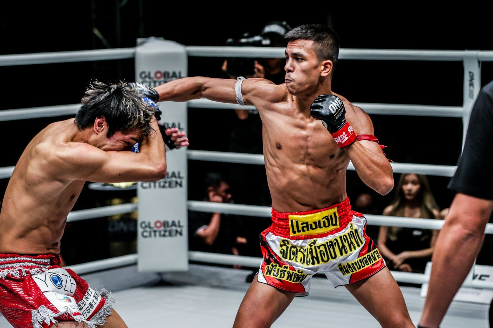 Muay Thai star Panpayak Jitmuangnon lands a right jab on his opponent