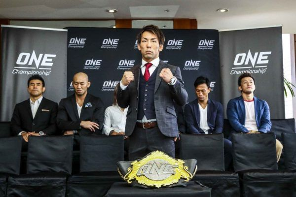"Yosuke ""The Ninja"" Saruta with the ONe Championship belt at the ONE CENTURY media day"