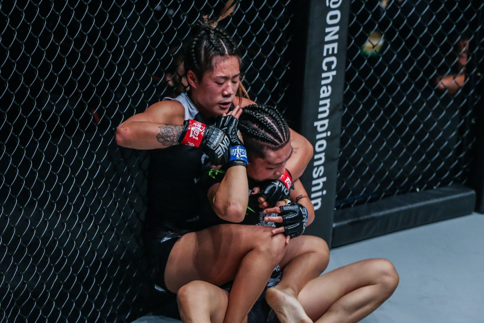 Angela Lee exchanges grapples with Xiong Jing Nan at ONE CENTURY