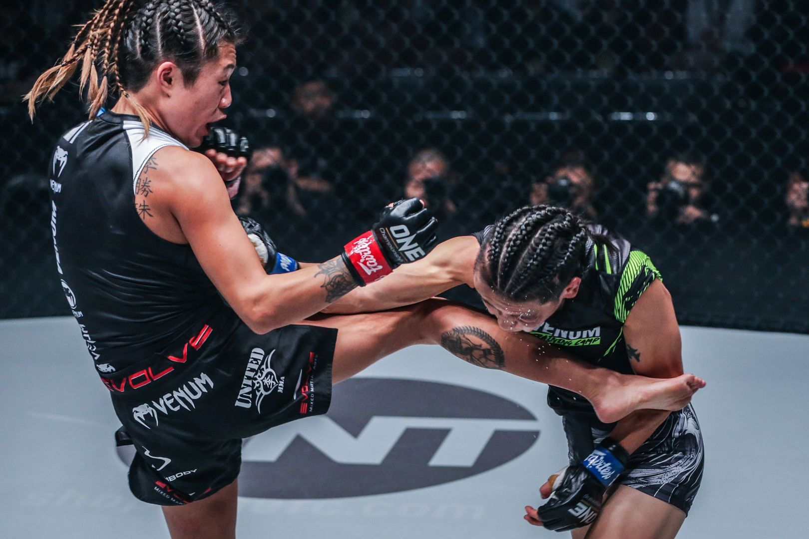 Angela Lee exchanges strikes with Xiong Jing Nan at ONE CENTURY