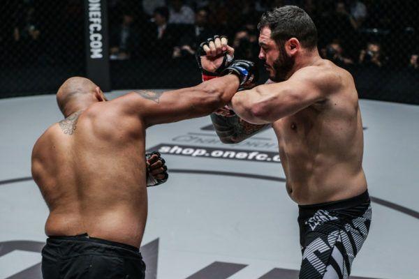 Arjan Bhullar lands a punch on Mauro Cerilli